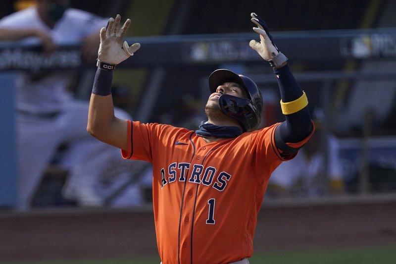 Springer y Correa dan victoria a Astros sobre Atléticos