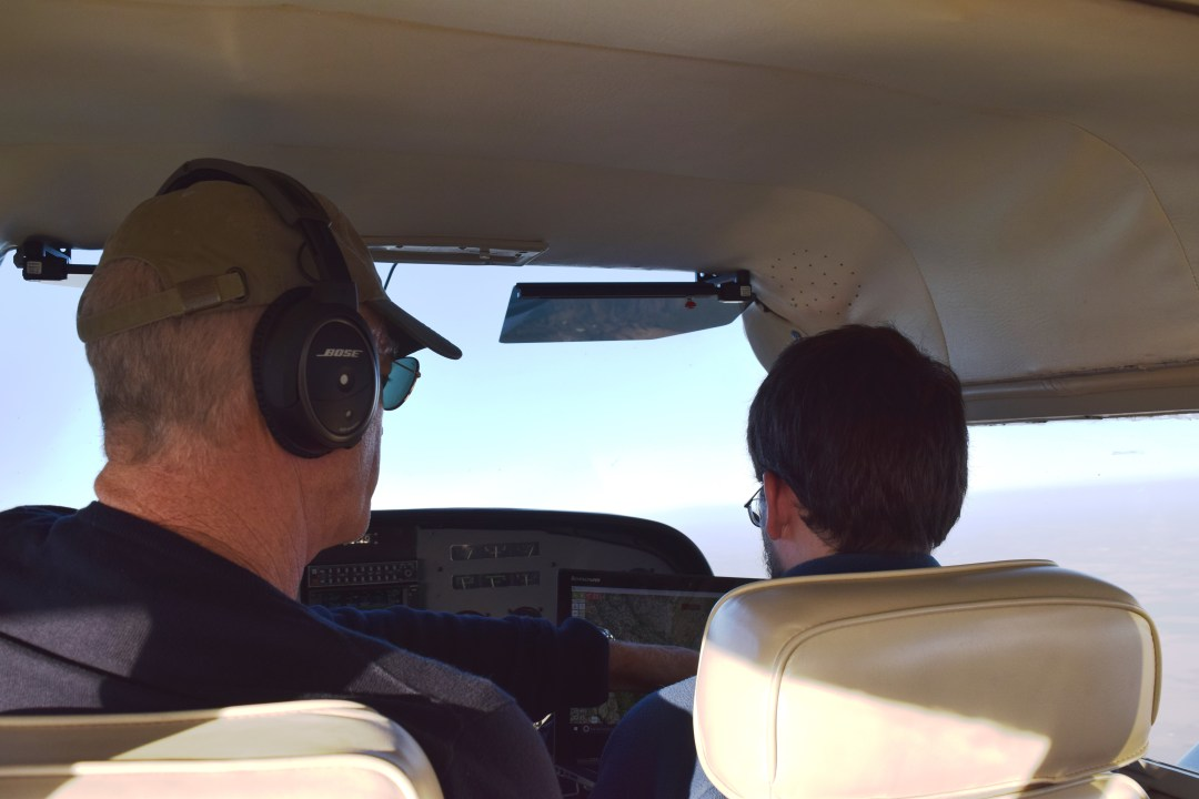 Pilot Charlie Amis and Vigilant Aerospace Developer Reed McCartney reviewing FlightHorizon live while up in the air.