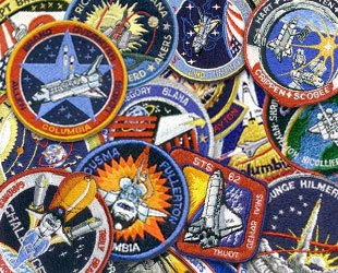 https://i2.wp.com/vigilantcitizen.com/wp-content/uploads/2011/06/astronaut_patches01a.jpg