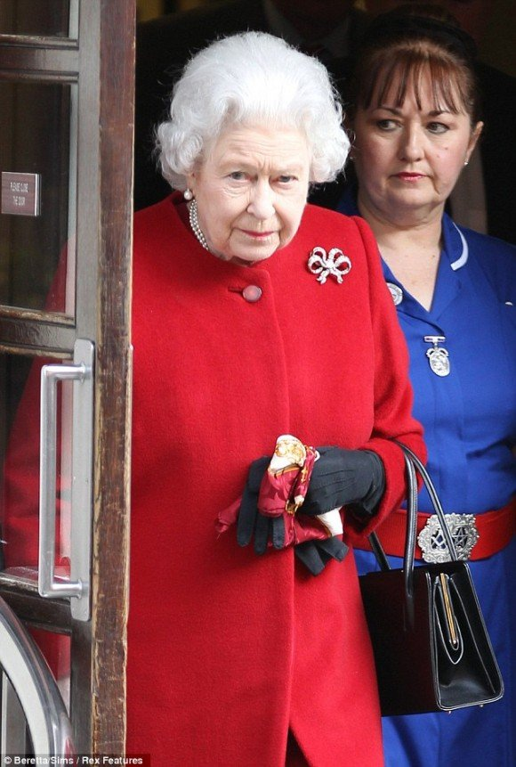 The Queen's nurse is wearing a belt buckle bearing Masonic symbols.