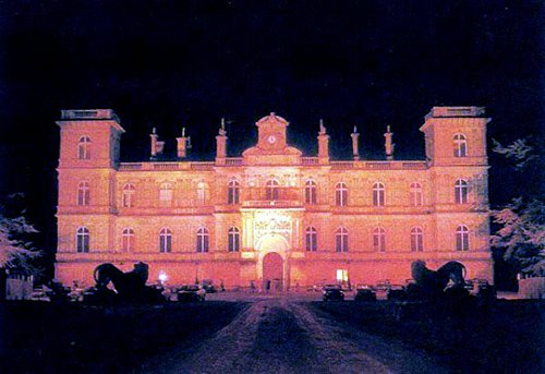 The Château de Ferrières was lit in red to make it appear as if it was on fire. This shot is almost identical to the Summerton Estate in Eyes Wide Shut where the masked ball took place.
