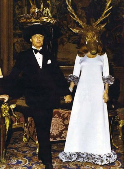 The host is dressed with a giant horned head.