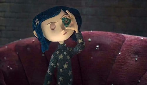 To find the ghost's missing eyes, Coraline must use a symbolic tool: A triangle with a hole in it. Is this a nod to the All-Seeing in triangle?