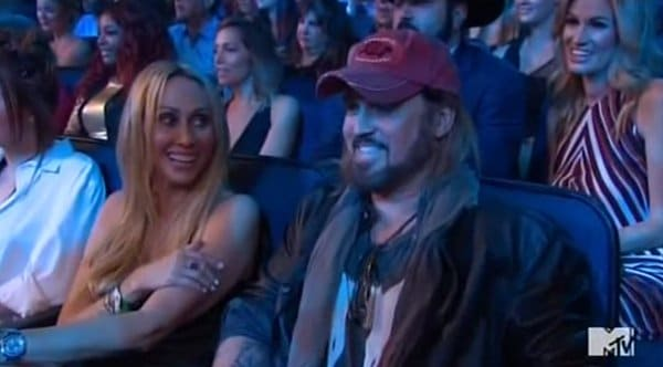 The camera then cuts to her father Billy Ray Cyrus who has to sit there and watch his daughter do a bunch of degrading stuff.