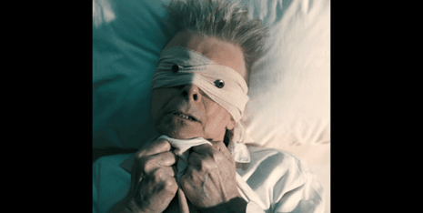 """In the role of the """"blind follower"""", we see Bowie as the simple man, the regular human who is physical weak, laying on his deathbed and scared of things to come."""