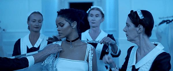 Rihanna, who is still wearing white, is being meseured for a brand new outfit. Her new, industry-friendly, persona is being created.