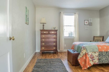 Chest of drawers and bed in the guestroom.