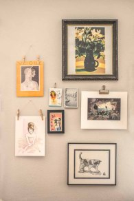 Eight prints make up a gallery wall in Stephanie's office.