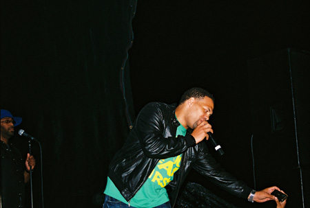 Roberson reaches for a fan's video camera and films himself performing. Photo by Leon Laing.