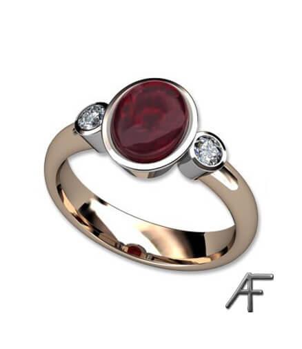 ring i vitt och rött guld med rubin