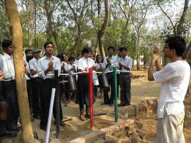 Dr. Pawan teaches kids a song to wash their hands clean