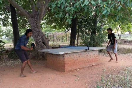 Arun playing table tennis with his son Madhavan