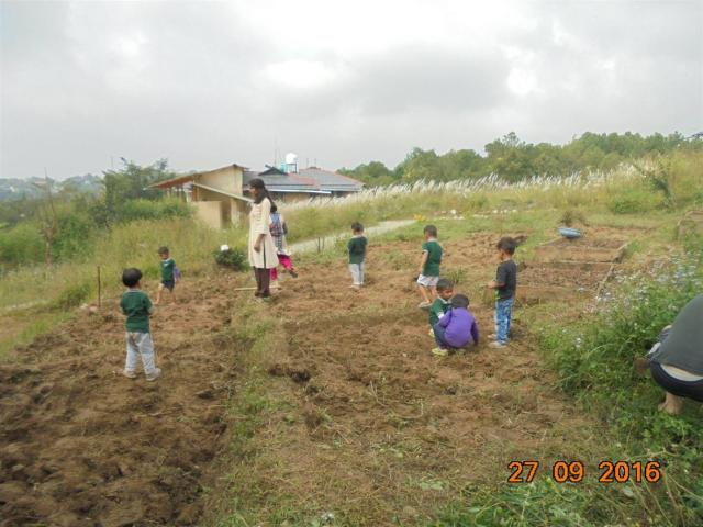 Kids learning to farm
