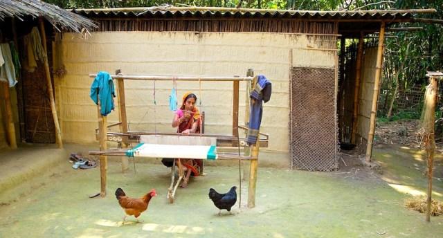 A weaver at work in an Assam village.