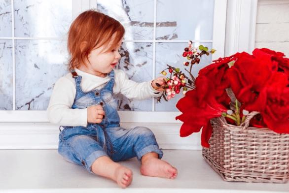 vika raskina - girl playing with flower