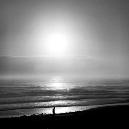 Foggy morning beach walker, Ormond Beach, FL