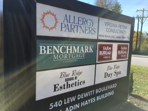 benchmark mortgage sign