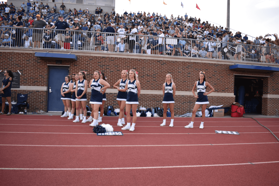 Berry cheerleaders and crowd during the moment of silence to honor Kay Williams.