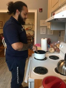 Stevens_Fabian Cummings_Junior Bonner cooks in shelter