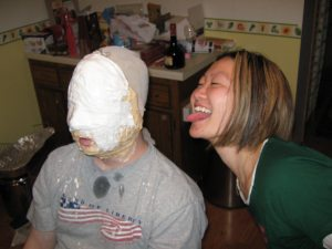 Christina watching as Gruben's new mask is fitted and molded to his face