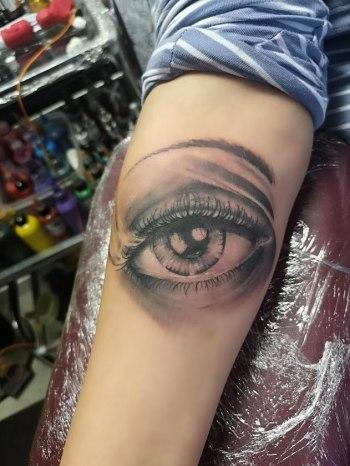 Photo realistic eye tattoo