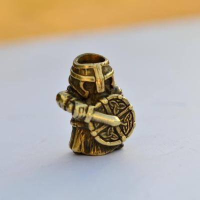 Фото латунная бусина Воин на паракорд
