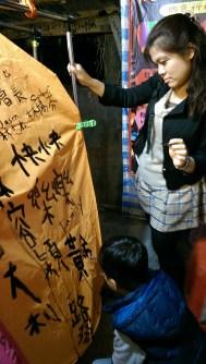 writing our wishes on a lantern/ пишем наши желания на китайском фонарике