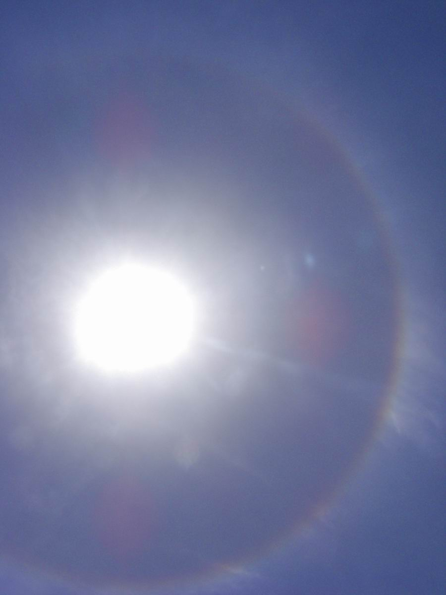 Cover photo of the rainbow around the sun