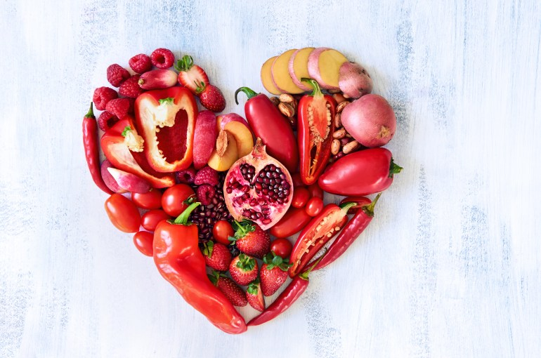 Red heart made from fresh raw fruits and vegetables