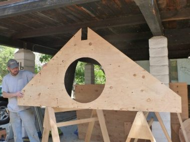kris-displays-the-plywood-sheathing-for-the-round-window