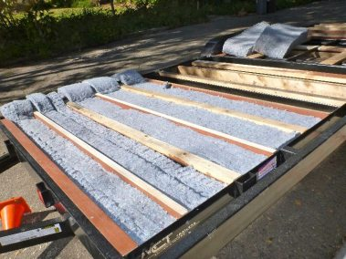 the-insulation-was-too-long-so-we-had-to-cut-them-down-and-tear-the-widths-to-fit-in-between-the-joists