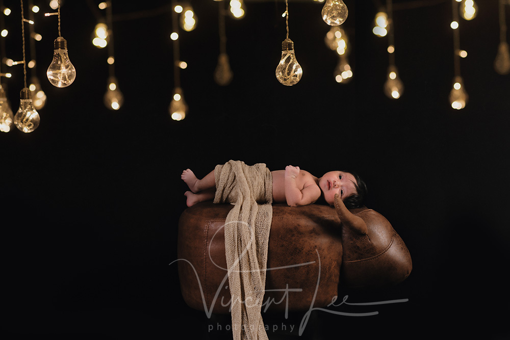 newborn with sister photoshoot portrait studio