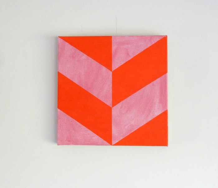 painting of red parallelogram planes on a pink surface