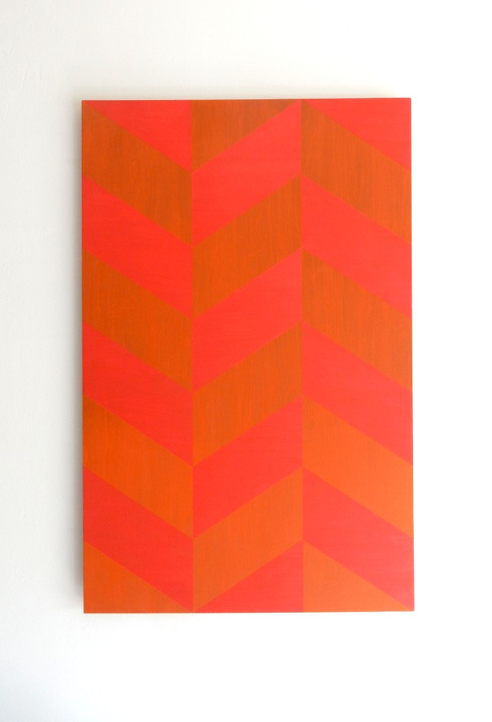 painting of red parallelogram planes on a kind of orange surface