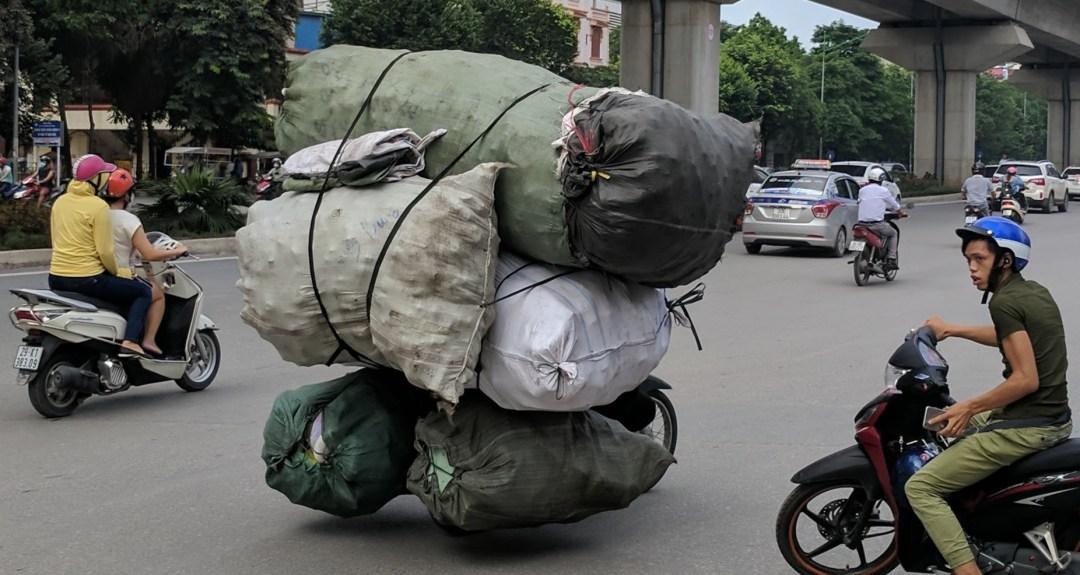 Talented motorbike driver delivering a massive, impressive load!