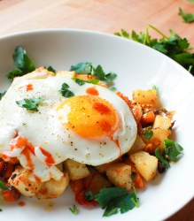 Spicy roasted potato and egg breakfast bowl