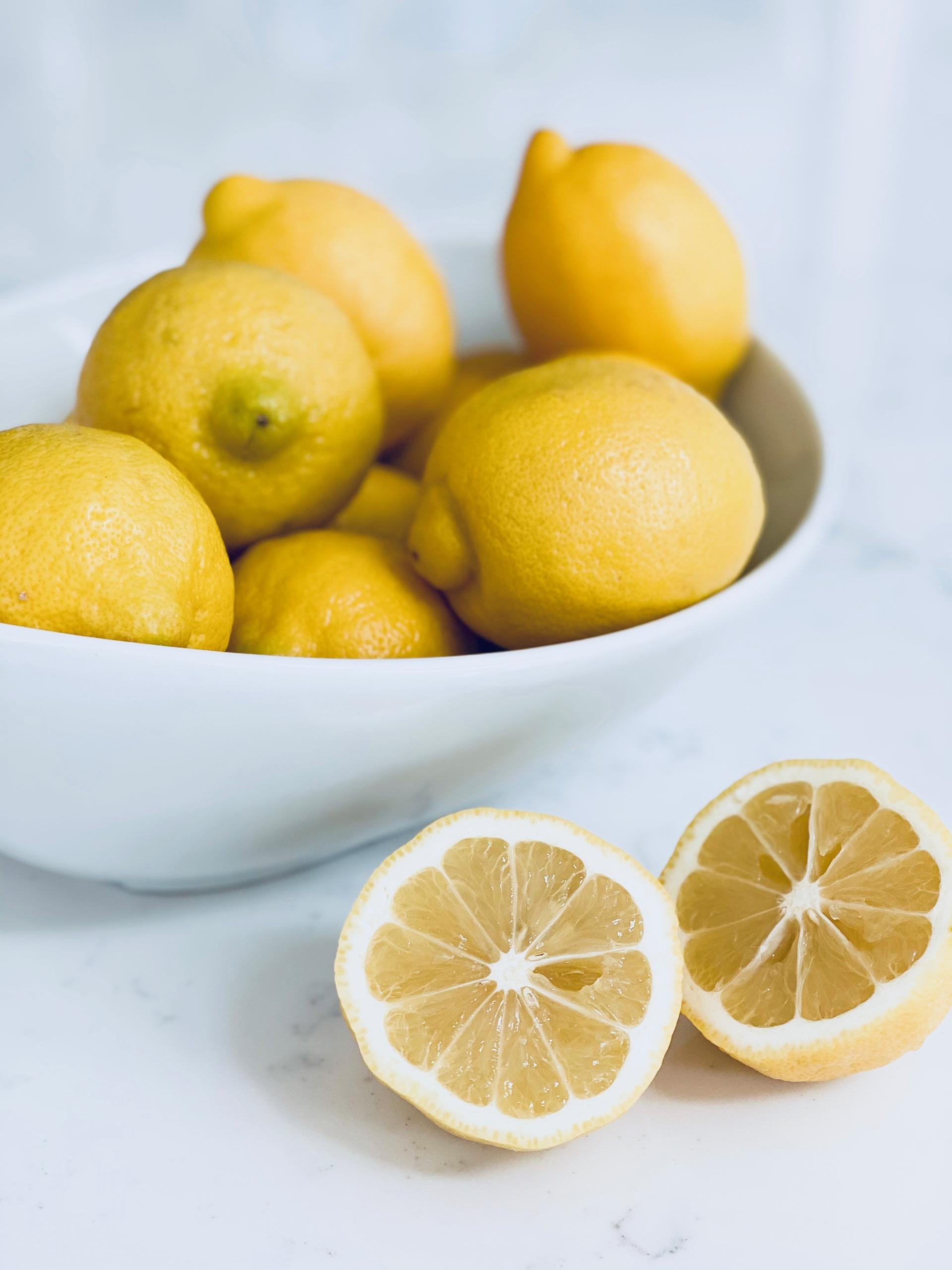 lemons on white counter in white bowl