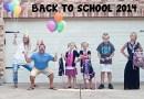 Эти мамы и папы очень рады тому, что их дети вернулись в школу.