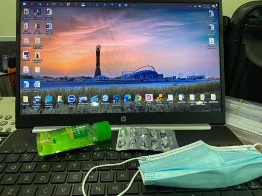 A professional in Doha, Qatar shows his daily essentials: hand sanitizer, disposable mask, and vitamins for coronavirus protection.