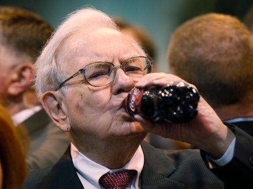 Warren Buffett drinks a bottle of Coca-cola (pic: Rick Wilking/Reuters)