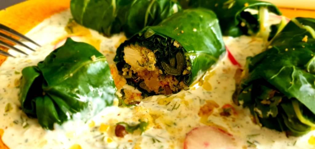 Рулады из мангольда с кускусом, фетой, зеленью на плато из соуса цацики