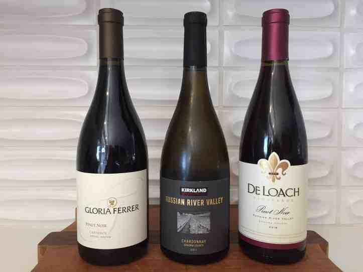 Three wine bottles.