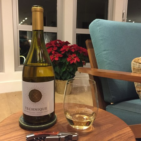 Bottle and glass of Technique Chardonnay from Costco.
