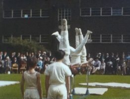 A still image from an Ilford 8mm film of an athletics display, possibly at a public school in the 1960s