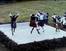 A Still from a vintage home movie showing a set of highland games from the 1960s