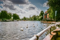 A picture of the river at Stratford on Avon showing the theatre and swans