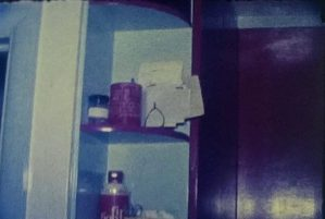 A still image from a vintage home movie showing a walk through of a home makeover 1960s style