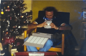 A still image from a vintage home movie showing a family Christmas at a house in Stevenage, Hertfordshire