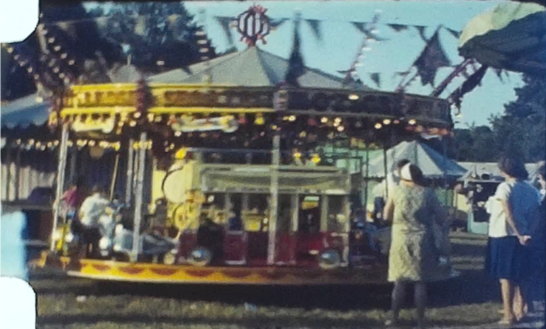 A still image from a vintage home movie shot at a steam fair and circus in 1964