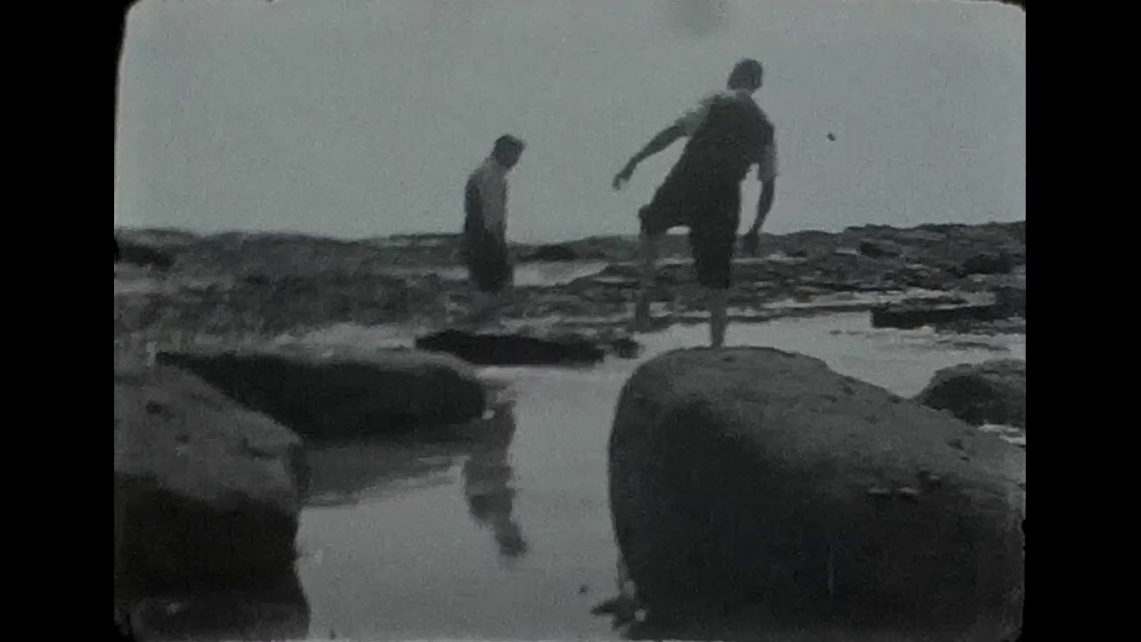A Black & White film on a rocky seafront in the 1950s